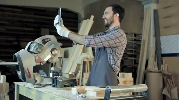 Thumbnail for Carpenter Makes Selfie Near Woodworking Machines in Carpentry Shop