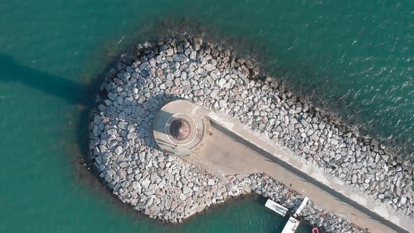 Top view of white lighthouse in blue lagoon. Alanya, Turkey.