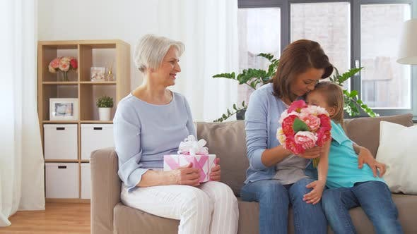 Thumbnail for Daughter Giving Flowers To Mother