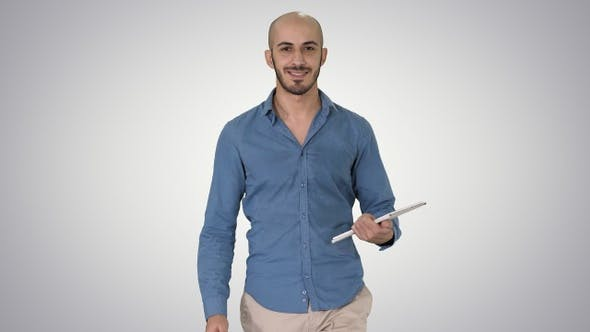 Thumbnail for Arab presenter walking with digital tablet swiping pages