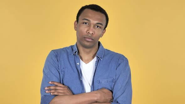 Cover Image for Young African Man Looking at Camera, Yellow Background
