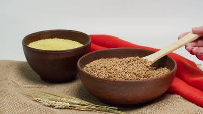 Taking Barley with Wood Spoon From Bowl