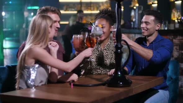 Thumbnail for Group of Friends Toasting Clinking Glasses in Bar