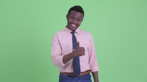 Happy Young African Businessman Giving Thumbs Up