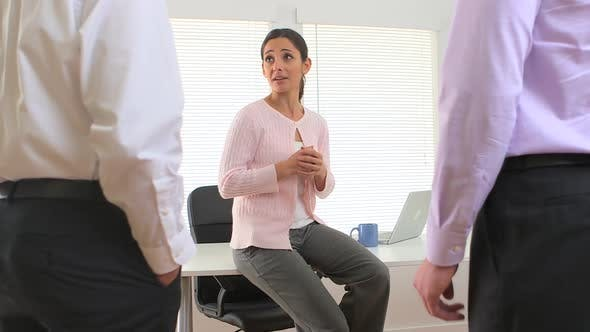 Female manager talking to employees