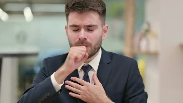 Thumbnail for Sick Young Businessman Coughing at Work