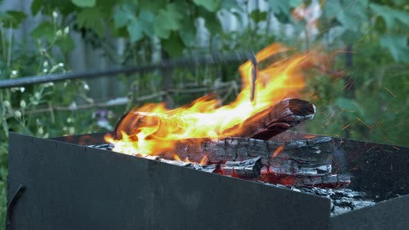Wood burning in fire flame. Preparing BBQ or grill. Firewood burning in grill.