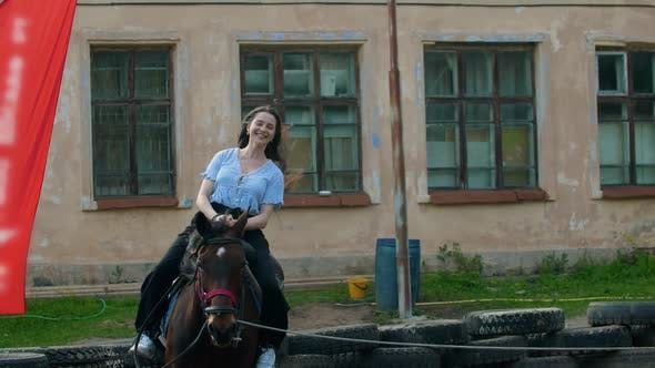 Thumbnail for Young Smiling Happy Woman with Long Hair Riding a Horse