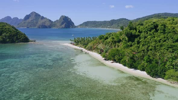 Thumbnail for Aerial Drone Fly Above Las Cabanas Sandy Beach with Palm Trees. El Nido in Background. Palawan