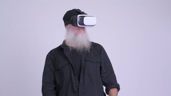 Thumbnail for Mature Bearded Hipster Man Using Virtual Reality Headset
