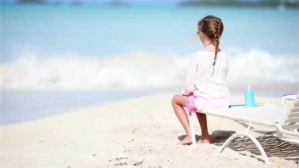 Thumbnail for Little Girl Enjoying on Sunbed on White Beach