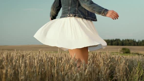 Thumbnail for Woman With White Skirt Dancing In Wheat Field