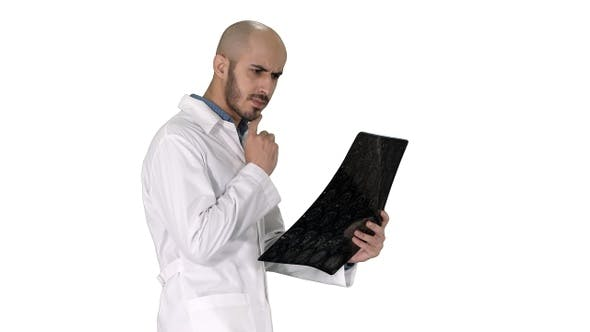 Thumbnail for Young male physician reading and reviewing a MRI brain