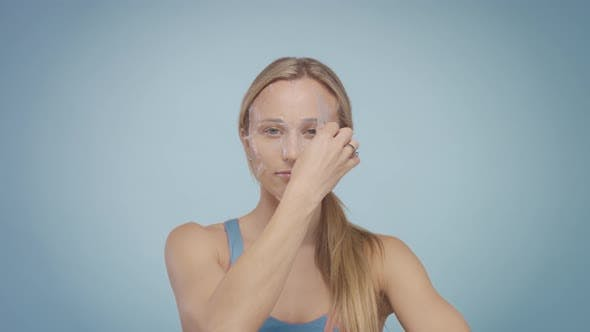 Thumbnail for Blonde Model During Facial Treatment Routine