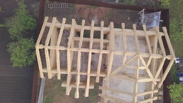 Thumbnail for Top view of frame of wooden house under construction
