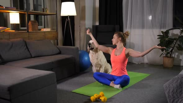 Thumbnail for Relaxed Female with Dog Practicing Yoga Lotus Pose