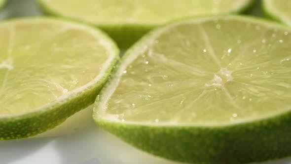 Thumbnail for Lime Slices Closeup, Macro Food Summer Background, Fruits Top View. Rotate
