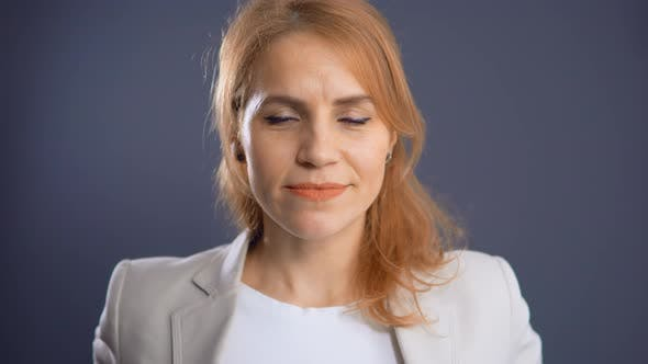 Thumbnail for Mature Business Lady Standing in Office