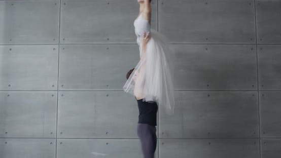 Elegant Couple of Classical Ballet Dancing on a Gray Background, Cinematic Shooting of a Romantic