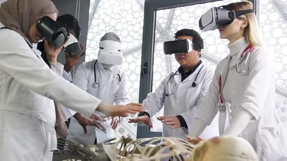Doctors of Surgeons Using Virtual Reality Glasses while Studying the Skeleton Mode