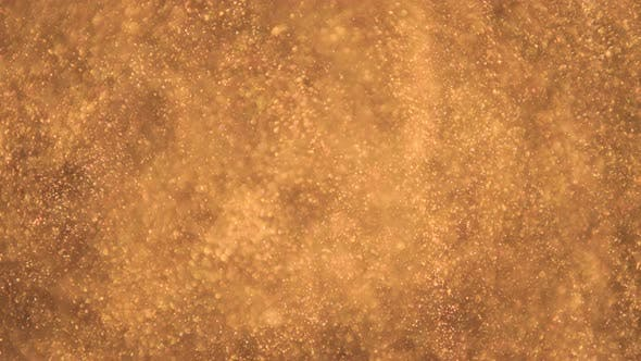 Elegant, Detailed, and Golden Particles Flow with Shallow Depth of Field Underwater