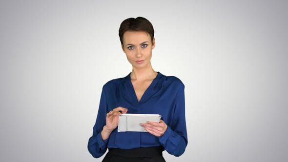 Thumbnail for Businesswoman Isolated Swiping the Tablet Presenting Something