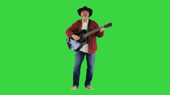 Thumbnail for Cowboy Man with Acoustic Guitar Singing a Song on a Green Screen, Chroma Key.