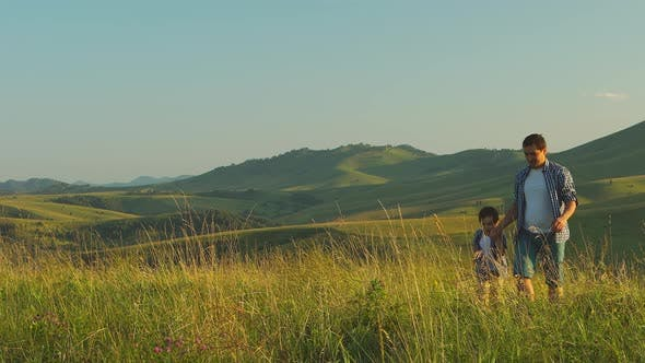 Thumbnail for Father with his son are walking (to and back) on scenic background