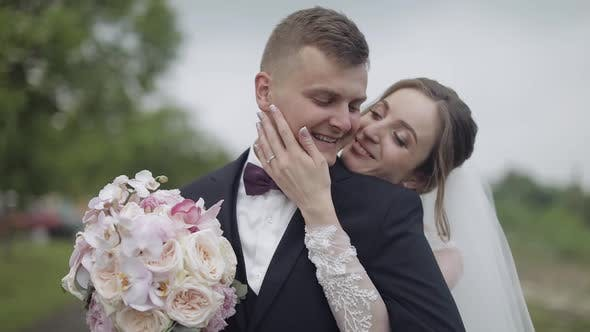 Thumbnail for Groom with Bride Hugging. Wedding Couple. Happy Family. Slow Motion