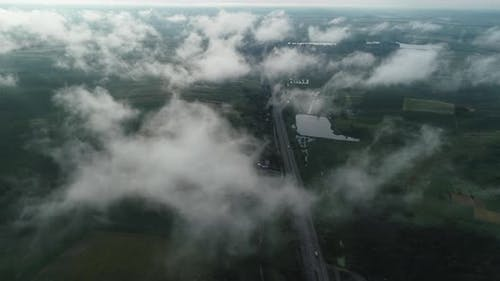Aerial View Of Highway With Cars. Traffic Is Visible Through The Clouds. Ukraine Rivne