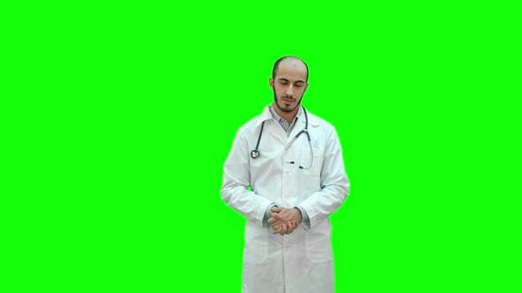 Thumbnail for Serious Male Doctor Talking To the Camera on a Green Screen, Chroma Key