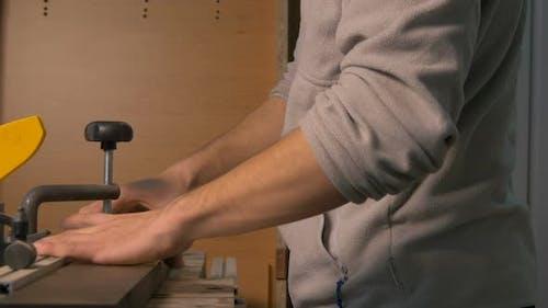 Carpenter pressing wood