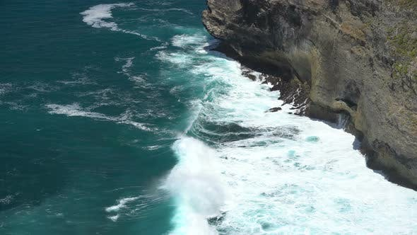 Ocean Waves Splashing Over Volcanic Rocky Shore