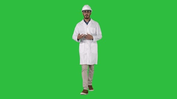 Thumbnail for Arab engineer presenting something talking to camera while