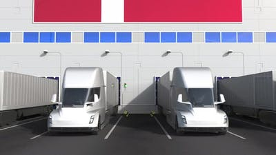 Electric Trucks at Warehouse Loading Dock with Flag of DENMARK