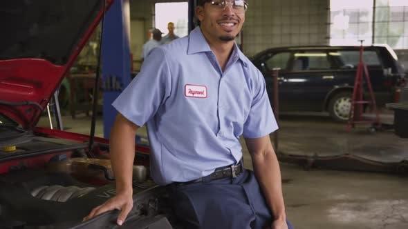 Thumbnail for Portrait of auto mechanic in repair shop