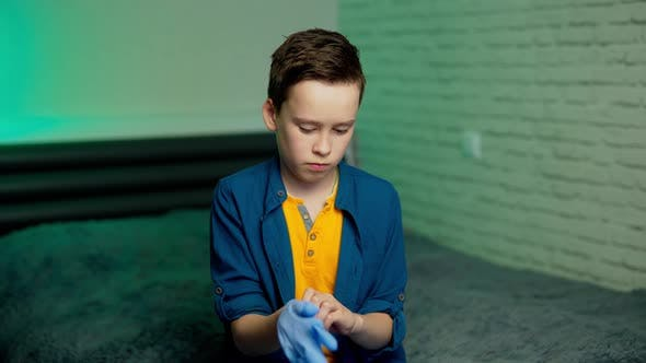 Thumbnail for Boy wearing a protection gloves