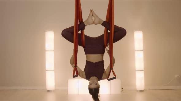 Thumbnail for Woman Meditating Upside Down in Hammock. Sportswoman Exercising Antigravity Yoga
