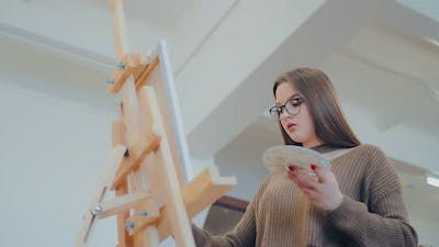 Young Woman Draws at the Easel