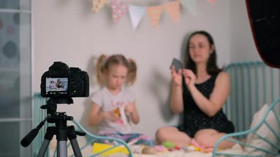 Little Girl with Mother Recording Video Tutorial