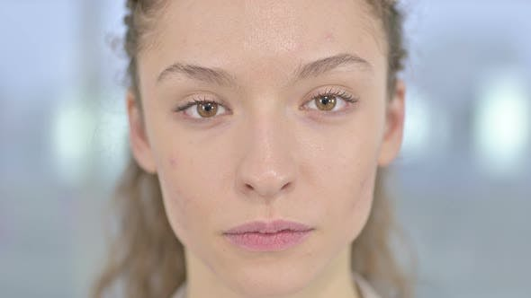 Thumbnail for Close Up of Serious Young Woman Looking at Camera