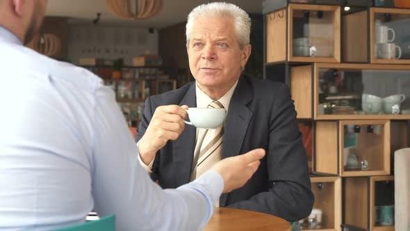 Cover Image for Senior Businessman Listens To His Partner