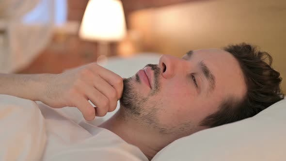Thumbnail for Portrait of Ambitious Young Man Thinking in Bed