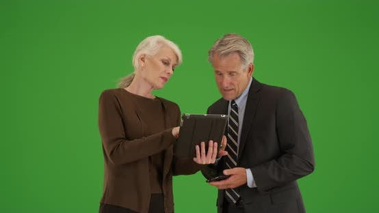 Thumbnail for Business team standing outdoors going over financial statistics on green screen