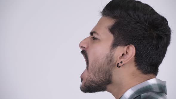Thumbnail for Face of Young Angry Bearded Indian Man Shouting and Screaming