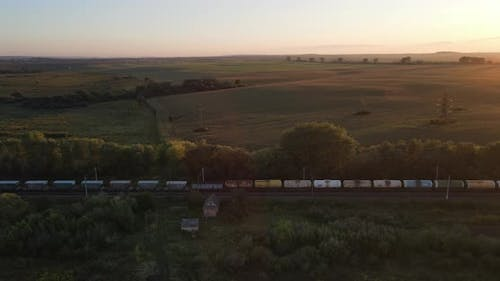 Freight Train Moves At Sunset