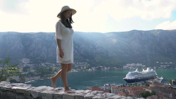 Girl Walking Along the Parapet at the Fortress Above Kotor