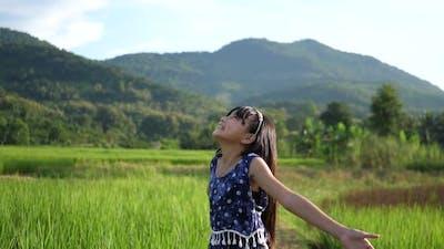 Asian Little Girl Enjoying