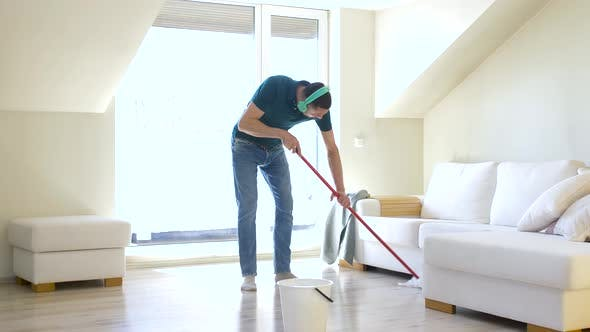 Thumbnail for Man in Headphones Cleaning Floor By Mop at Home 20