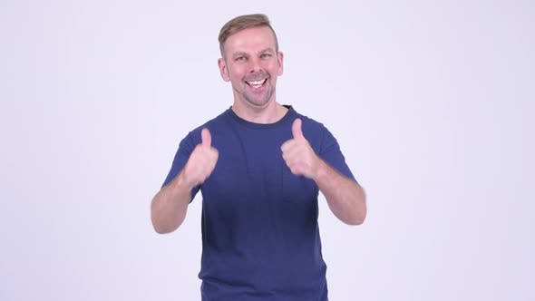 Thumbnail for Portrait of Happy Blonde Man Looking Excited and Giving Thumbs Up